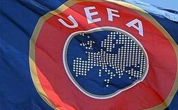 УЕФА наказала сборную России за буйных фанатов